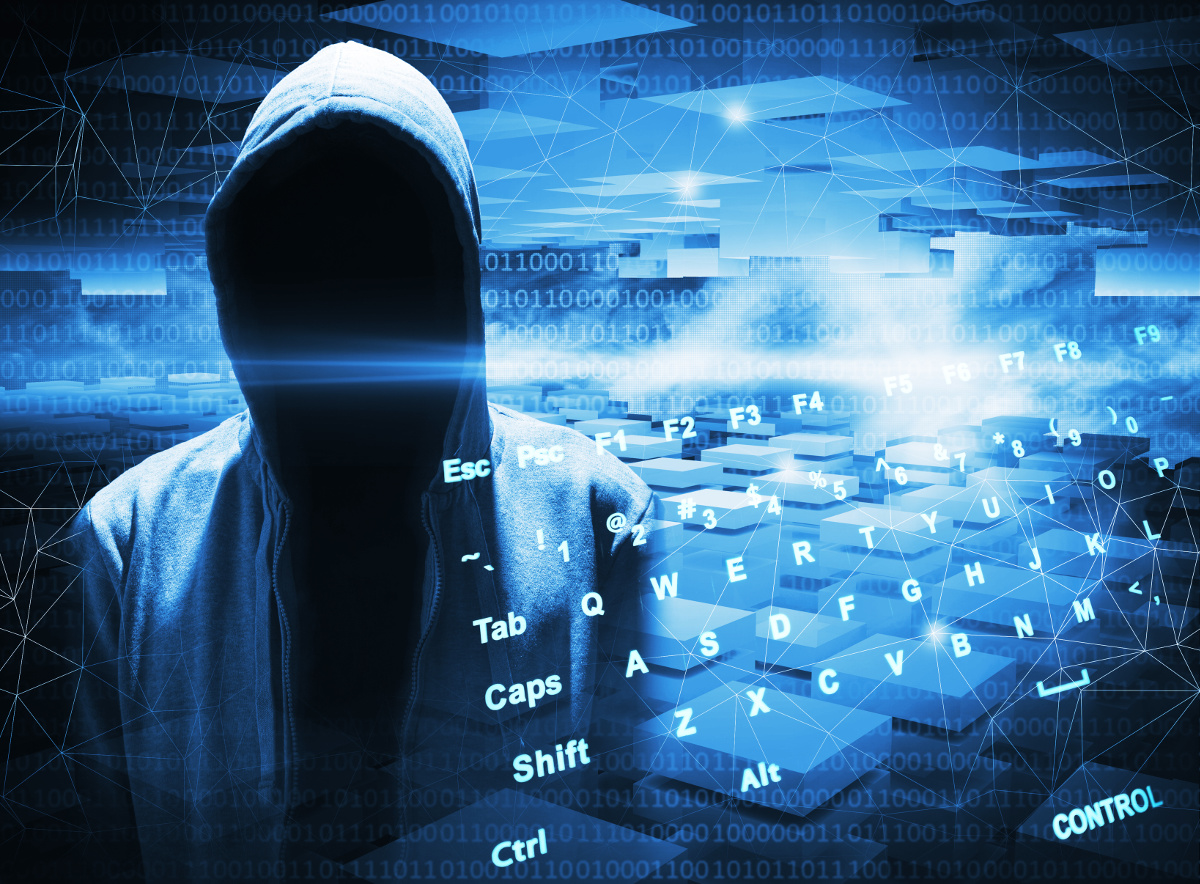 Empty hooded figure against an abstract blue field of computer code