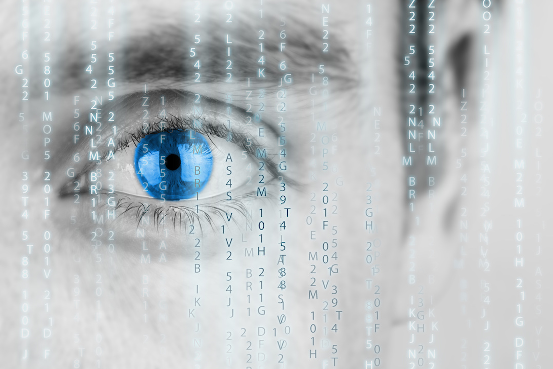 Futuristic image with human eye with blue iris and matrix texture surveillance